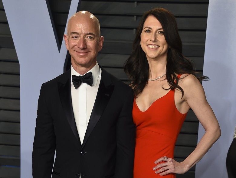 In this March 4, 2018, photo, Jeff Bezos and wife MacKenzie Bezos arrive at the Vanity Fair Oscar Party in Beverly Hills, California. (Evan Agostini/Invision/AP, file)