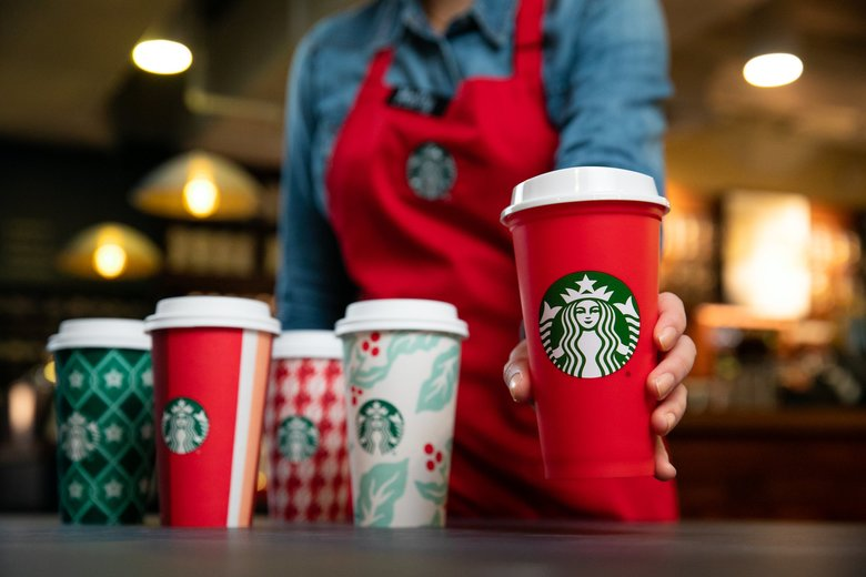 Starbucks' holiday cup designs have been a magnet for controversy over the years. This season the company is hoping to use them to draw customers back to the stores in the typically slow afternoon period. (Joshua Trujillo / Starbucks)