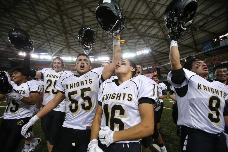 Royal's Valente Cortez-Lopez (55) and Steven Toro (16) celebrate after the class 1A state title football game between Royal High School and King's School, Saturday, December 5, 2015, at the Tacoma Dome. Royal defeated King's, 28-7.   (Sy Bean / The Seattle Times)