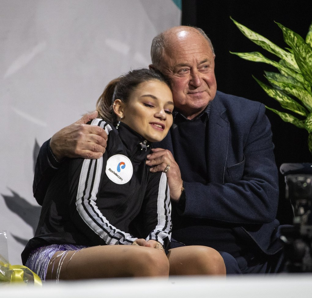 Sofia Samodurova of Russia falls into the arms of her coach, Alexi Mishin, following her free skate Sunday.  Samodurova won the bronze medal with her performance. (Dean Rutz / The Seattle Times)
