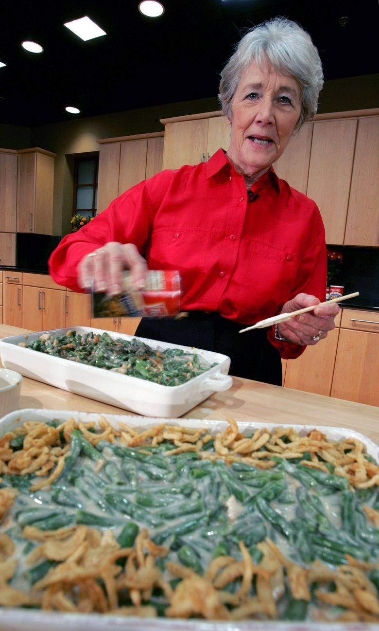 A green-bean cassorole sits in the foreground as Dorcas Reilly prepares another at the Campbell Soup Co. corporate kitchen in Camden, N.J., in 2005. Reilly died on Oct. 15 of Alzheimer's disease in Haddonfield, New Jersey. Reilly was a Campbell Soup kitchen supervisor in 1955 when she combined green beans and cream of mushroom soup, topped with crunchy fried onions, for an Associated Press feature. It is the most popular recipe ever to come out of the corporate kitchen at Campbell Soup.