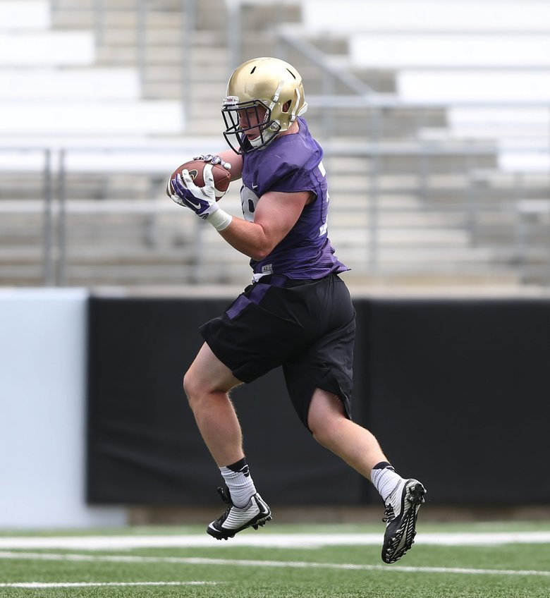 Former UW defensive back Hayden Schuh catches a pass at Huskies fall camp in 2015. (The Seattle Times, file)