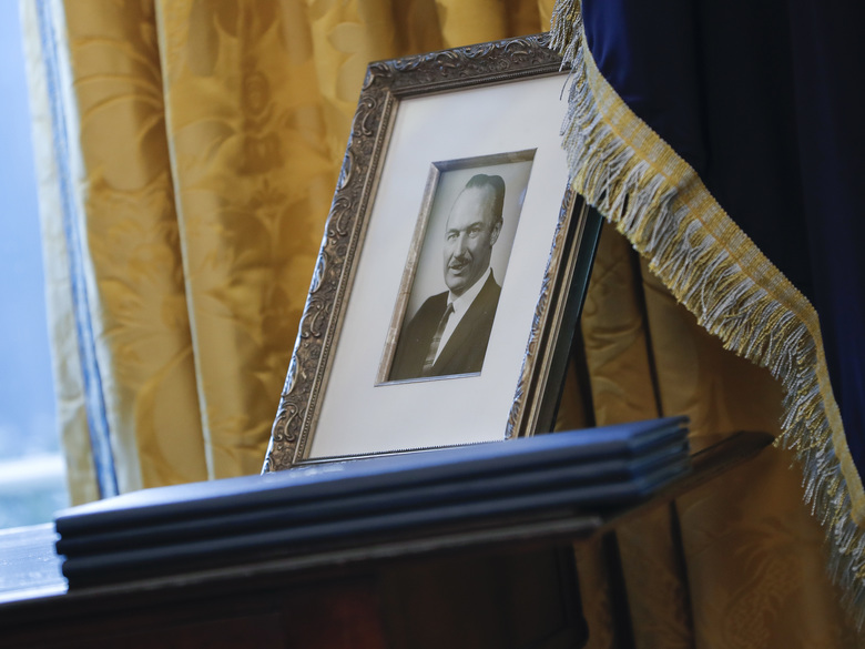 In this Feb. 9, 2017, file photo, a portrait of President Donald Trump's father Fred Trump is seen in the Oval Office of the White House in Washington. The New York Times is reporting that President Donald Trump received at least $413 million from his father over the decades, much of that through dubious tax dodges, including outright fraud. (AP Photo/Pablo Martinez Monsivais, File)