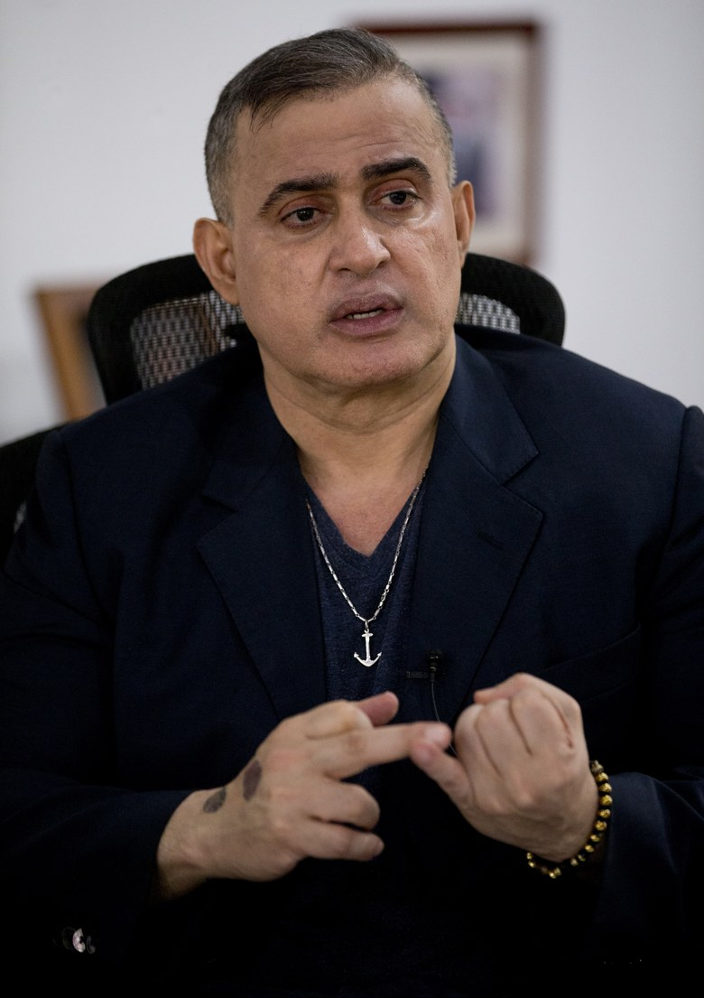 Venezuela's Chief Prosecutor Tarek William Saab speaks during a interview with the Associated Press at his office in Caracas, Venezuela, Thursday, Oct. 18, 2018. Saab said he is investigating the police officers who failed to keep safe an opposition politician who plunged from the 10th-floor of a high-security building even as he rejects calls for an independent probe into what authorities contend was a suicide. (AP Photo/Ariana Cubillos)