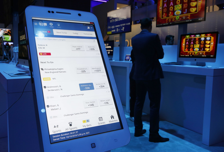 The OpenBet mobile sports betting app is on display at the Scientific Games booth during the Global Gaming Expo, Wednesday, Oct. 10, 2018, in Las Vegas. (AP Photo/John Locher)