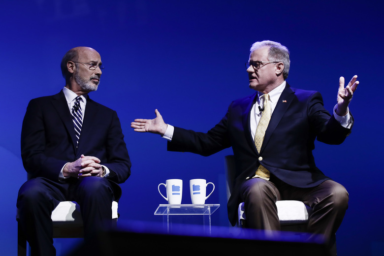 Republican Scott Wagner, right, and Democratic Gov. Tom Wolf take part in a gubernatorial debate in Hershey, Pa., Monday, Oct. 1, 2018. The debate is hosted by the Pennsylvania Chamber of Business and Industry. (AP Photo/Matt Rourke)