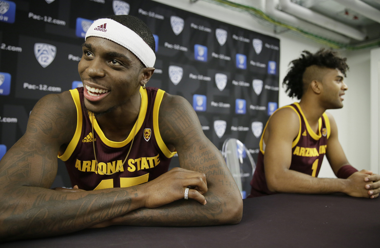 Arizona State's Zylan Cheatham, left, and Remy Martin, right, answer questions during the Pac-12 NCAA college basketball media day Thursday, Oct. 11, 2018, in San Francisco. (AP Photo/Eric Risberg)