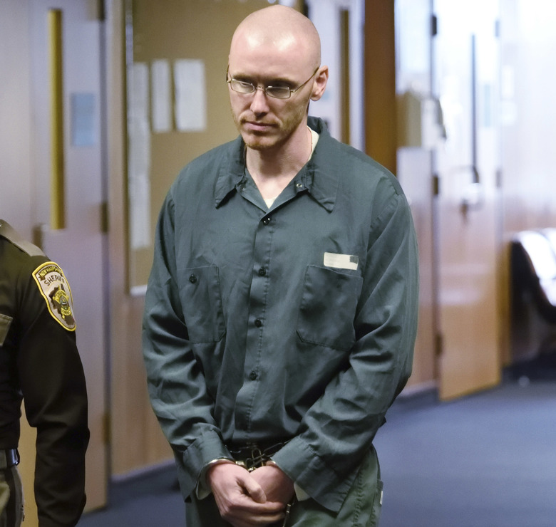 Robert Dingman appears in Strafford Superior Court for a for a resentencing hearing, Tuesday, Oct. 30, 2018, in Dover, N.H. A judge lifted the life sentence Tuesday for  Dingman, now 40, who killed his parents and stashed them in garbage bags as a teenager, making him eligible for release in 17 years. (John Huff/Foster's Daily Democrat via AP)