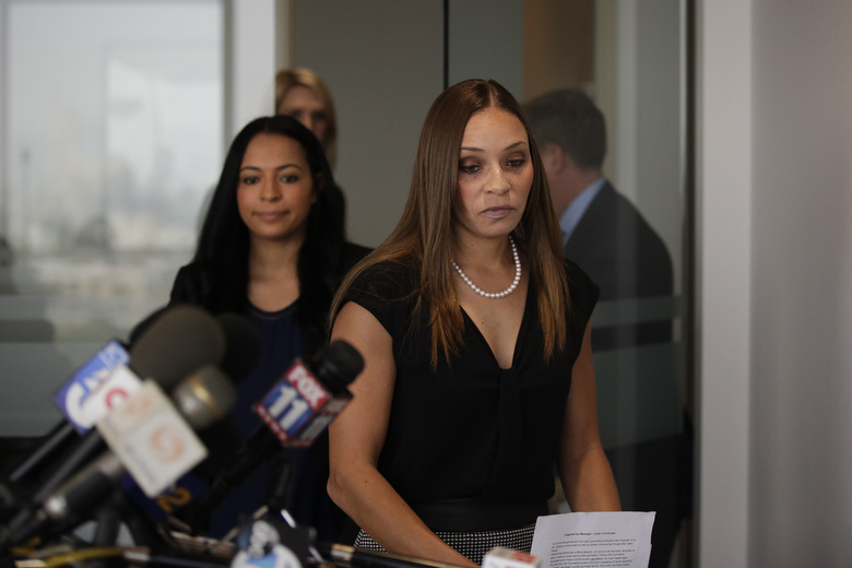 Former national gymnasts Jordan Schwikert, center, and sister, Tasha, arrive for a news conference Monday, Oct. 29, 2018, in Los Angeles. The two have sued USA Gymnastics for allegedly enabling and failing to prevent sexual abuse by the team's former doctor, Larry Nassar. (AP Photo/Jae C. Hong)