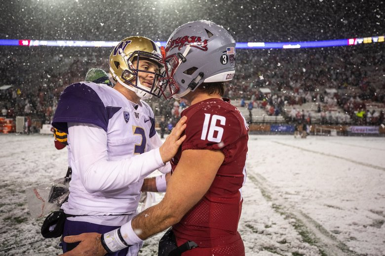 Jake Browning and Gardner Minshew meet after the game. The University of Washington Huskies played the Washington State Cougars in the 2018 Apple Cup game