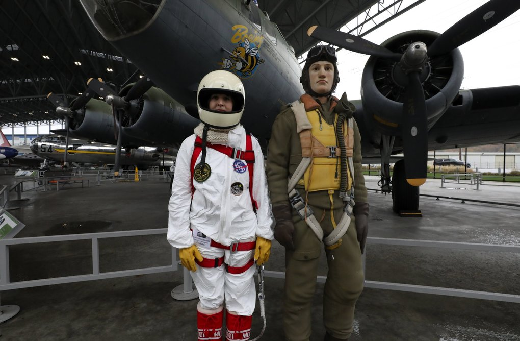 Christine Zuercher, known as the Spacewoman of the Underground, came to the Museum of Flight's Space Expo and wears her homemade astronaut suit.  The mannequin next to her wears a World War II flight suit appropriate for the B-17 bomber behind them.  Zuercher teaches graphic design at Kent State University.  She came to help the public's understanding of scientific advancement. (Alan Berner / The Seattle Times)