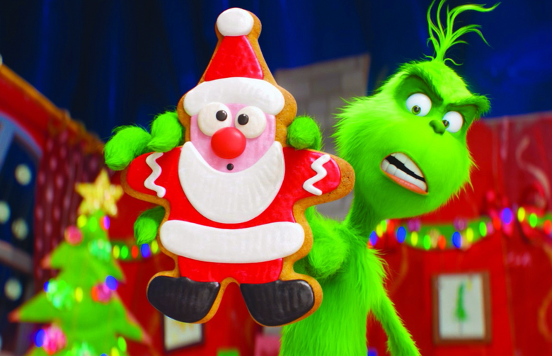 "The Grinch (voiced by Benedict Cumberbatch) warns of the seductive power of the Santa cookie in ""Dr. Seuss' The Grinch."" (Illumination and Universal Pictures)"