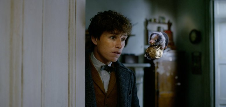 "Eddie Redmayne as Newt Scamander with a Baby Niffler in ""Fantastic Beasts: The Crimes of Grindelwald.""    (Courtesy of Warner Bros. Picture )"