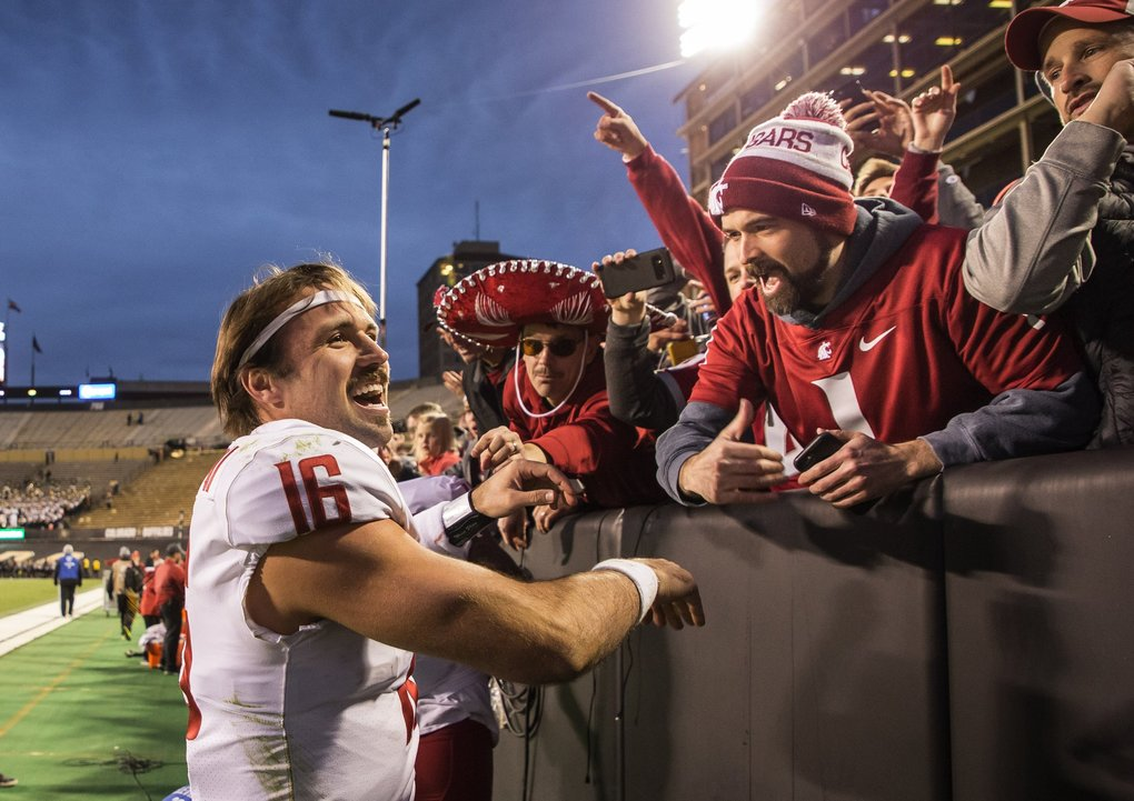 Washington State quarterback Gardner Minshew celebrates with Cougar fans after Saturday's 31-7 win over Colorado. (Dean Rutz / The Seattle Times)