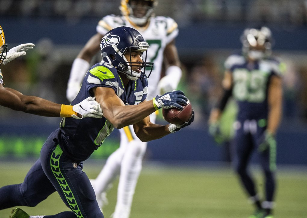 Tyler Lockett comes up with a 34-yard pass reception in the fourth quarter.   (Dean Rutz / The Seattle Times)