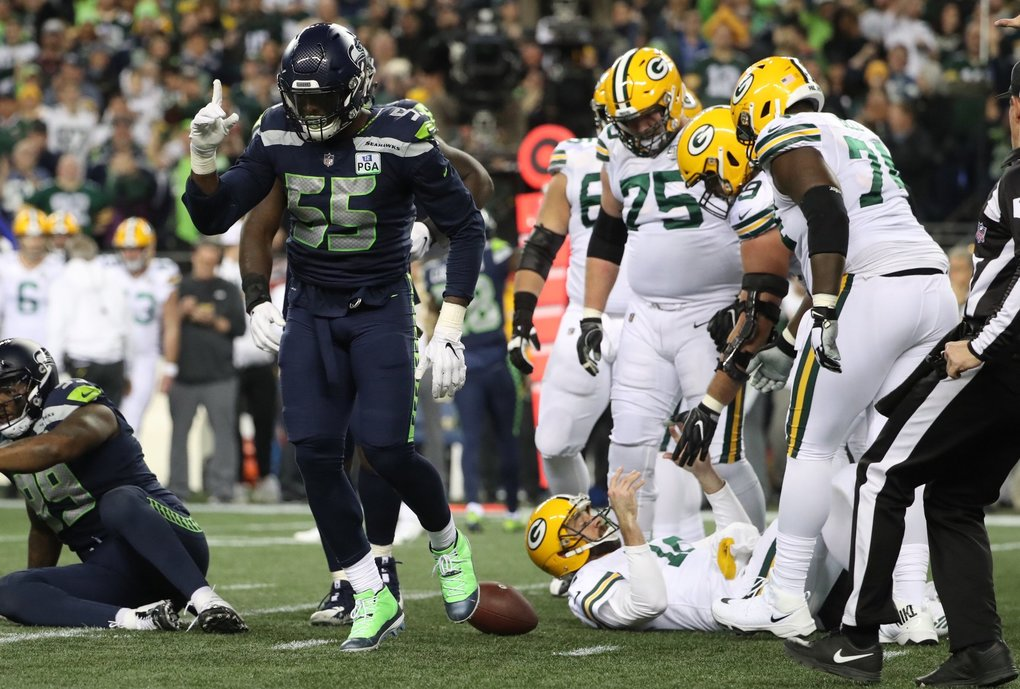 Frank Clark celebrates a sack on Aaron Rodgers on third down in the second quarter as the Seattle Seahawks take on the Green Bay Packers at CenturyLink Field in Seattle Thursday November 15, 2018.  (Bettina Hansen / The Seattle Times)