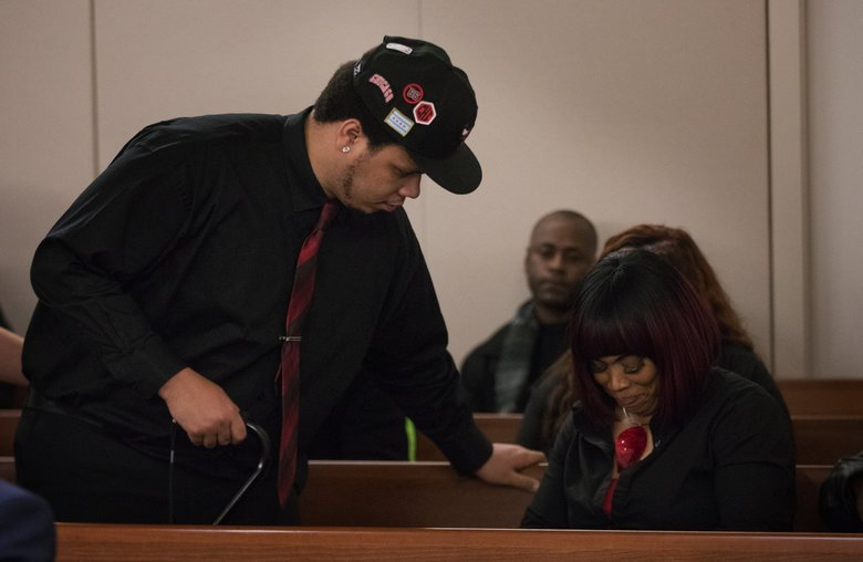 DaShawn Horne looks at his mother, LaDonna Horne, after returning to the courtroom Friday. DaShawn Horne had left the room when prosecutors began playing a cellphone video Julian Tuimauga shot after beating the young man in January. (Ellen M. Banner / The Seattle Times)