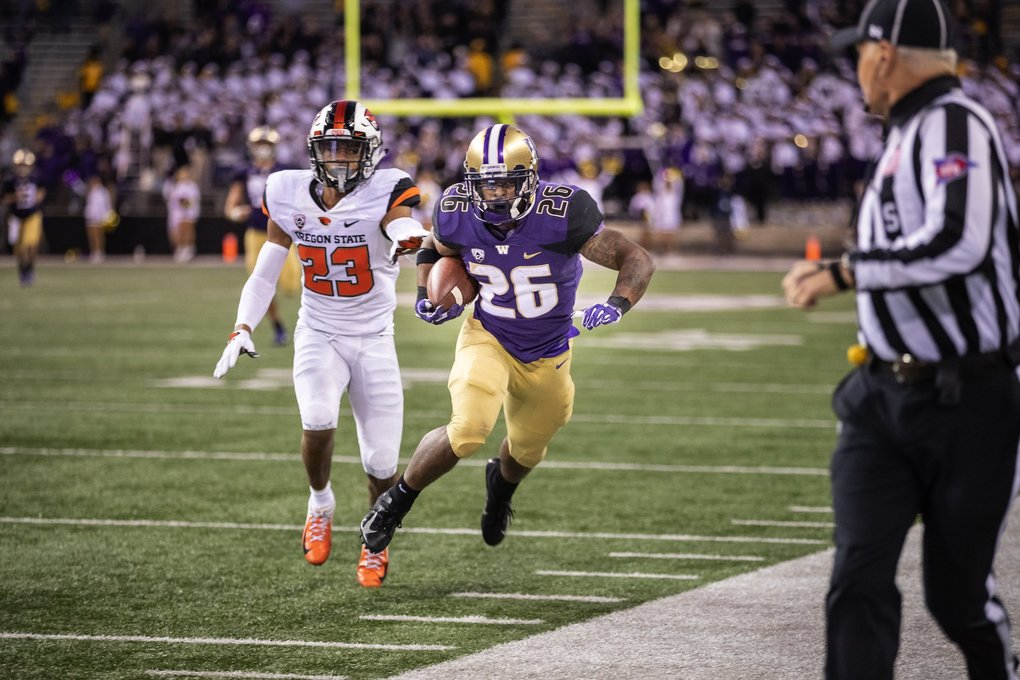 Late in the fourth quarter and with Washington staring at 3rd down, Salvon Ahmed breaks loose with his biggest run of the night, a 59-yard rush to the OSU 13. (Dean Rutz / The Seattle Times)