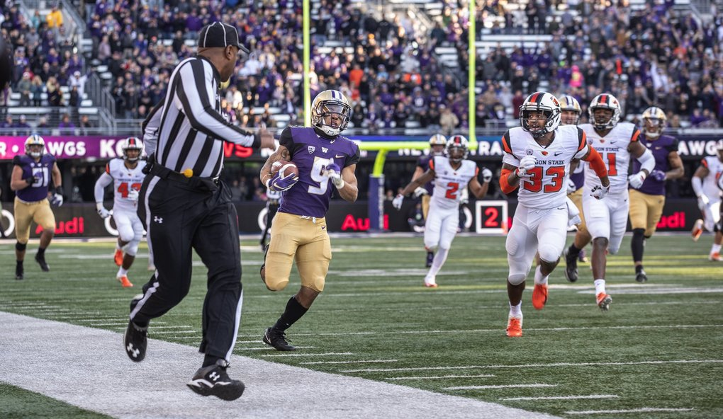 Myles Gaskin is off and running on a 54-yard carry in the first quarter.   (Dean Rutz / The Seattle Times)