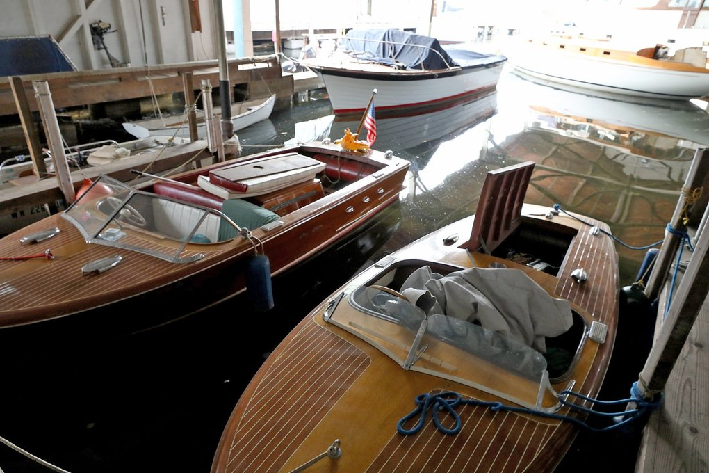 At Jensen Motor Boat on Portage Bay, two vintage, all-wood Chris Craft runabouts are stored in the foreground. (Greg Gilbert / The Seattle Times)