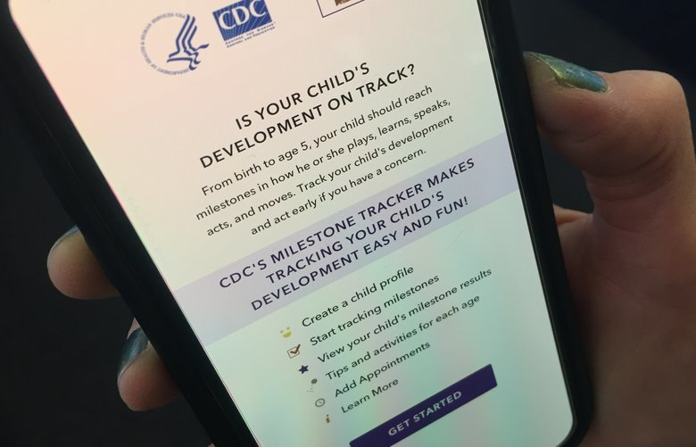 The Milestone Tracker phone app from the Centers for Disease Control and Prevention is displayed on Thursday, Nov. 22, 2018, in New York. The app was created to help parents recognize developmental delays.   (AP Photo/Jenny Kane) NYJK901 NYJK901