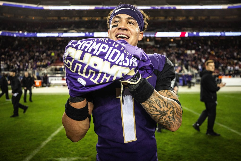 Byron Murphy puts on his Pac-12 Championship t-shirt after the Huskies defeated Utah 10-7 to win the conference title.  Bryant had two interceptions – including a pick-6 – and was named MVP. (Dean Rutz / The Seattle Times)