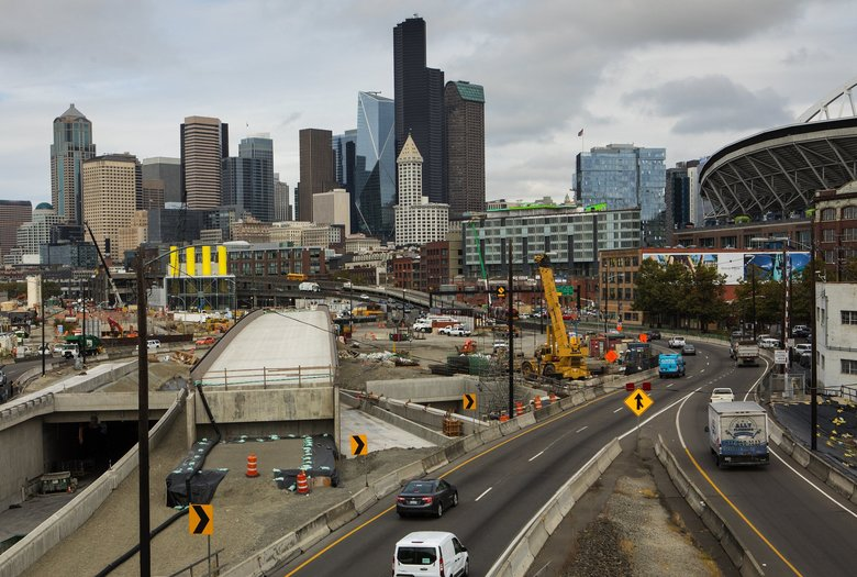 The existing northbound onramp from the stadium area to the Alaskan Way Viaduct (see the white-and-blue truck at right) will close Jan. 4, or a week earlier than the permanent viaduct shutdown Jan. 11.  When the replacement tunnel opens in early February, drivers at this site will descend from a Sodo interchange to Highway 99 using a downward ramp, shown here between the unfinished exit bridge and yellow crane.  (Ellen M. Banner / The Seattle Times, Sept. 25, 2017)
