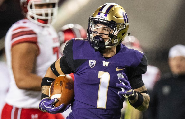 Byron Murphy returns the intereption 66-yards for a touchdown in the 3rd quarter against Utah.  The 11th-ranked Washington Huskies played the 17th-ranked Utah Utes in the Pac-12 Championship game at Levi's Stadium in Santa Clara, CA, Friday November 30, 2018. 208603