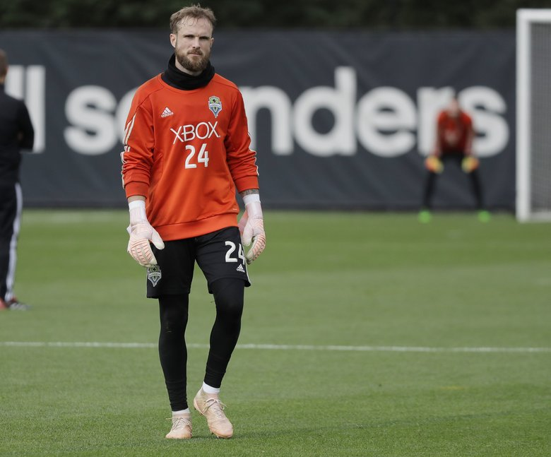 Sounders goalkeeper Stefan Frei, seen here practicing Wednesday, doesn't want to discuss his being beaten out in year-end awards voting, preferring instead to focus on Thursday's must-win playoff match at CenturyLink Field against the Portland Timbers. (Ted S. Warren / The Associated Press)
