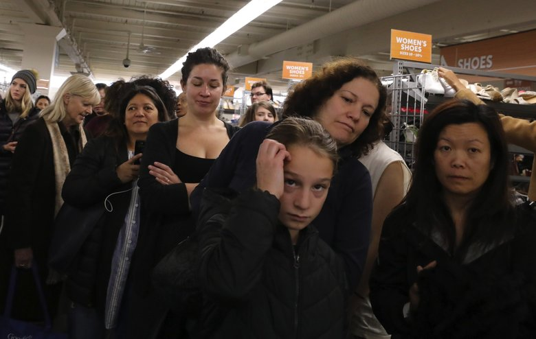 Glitter Sale shoppers wait to be admitted to the area for the designer, vintage and one-of-a-kind items.  Between 2,500 to 3,000 are expected to shop over the two-day event that ends Sunday. (Alan Berner / The Seattle Times)