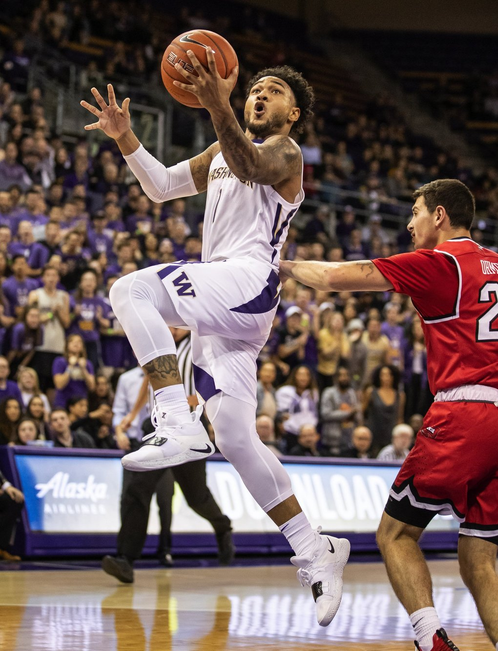 Washington's David Crisp blows by Western Kentucky's Jake Ohmer on his way to the basket in the 2nd half.   (Dean Rutz / The Seattle Times)