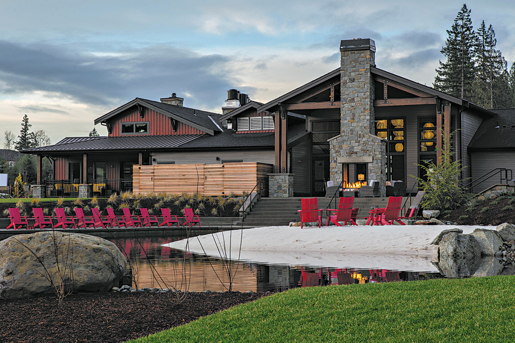 Seven Summits Lodge includes an upscale restaurant; a fitness studio and indoor pool; a game room with poker tables; a culinary studio; and a lawn for outdoor events.