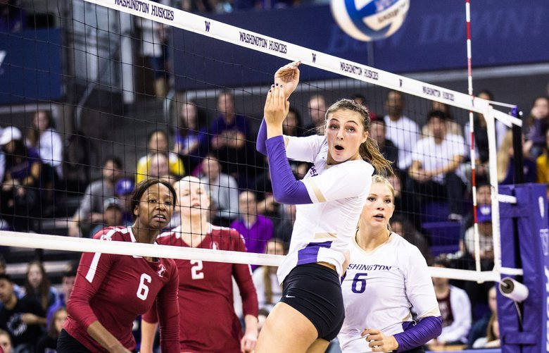 Washington's Kara Bajema (left) and Avie Niece watch as Stanford gets the ball past them as the Huskies take on Stanford Cardinal at Alaska Airlines Arena on Sunday, November 18. Stanford won 3 sets over the Huskies, 208517