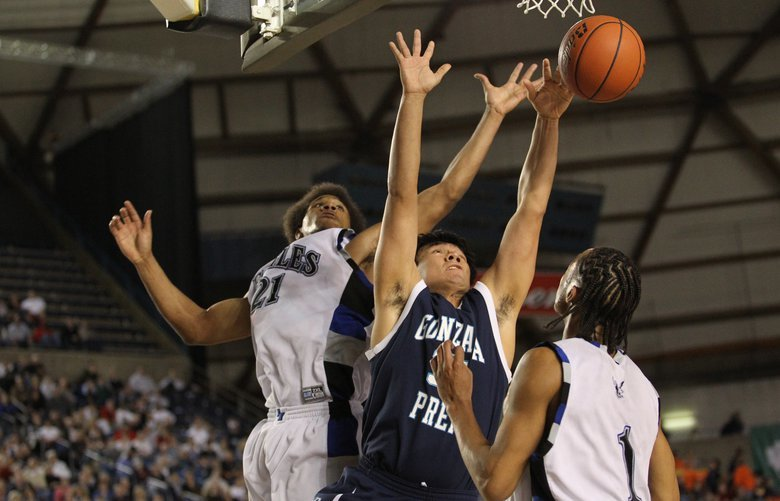 4A BASKETBALL FEDEREAL WAY VS GONZAGA PREP – TACOMA – 030410  Gonzaga Prep's David Nelson loses the ball to Federal Way's George Williams and Tyrell Lewis during the Federal Way vs. Gonzaga Prep 4A boys basketball game Thursday, March 4, 2010 at the Tacoma Dome in Tacoma, Wash. Federal Way beat Gonzaga in overtime, 60-59.