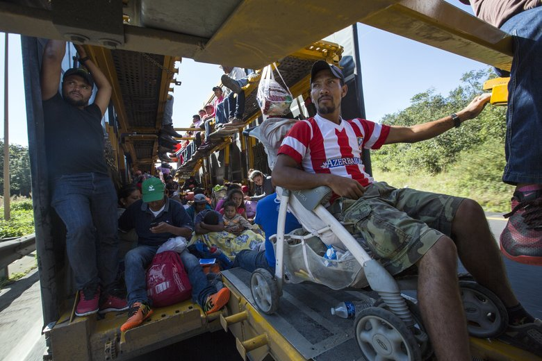 Central American migrants begin their morning trek with a free ride on a truck, as part of a thousands-strong caravan hoping to reach the U.S. border as they leave Cordoba, Veracruz state, Mexico, Monday, Nov. 5, 2018. A big group of Central Americans pushed on toward Mexico City from a coastal state Monday, planning to exit a part of the country that has long been treacherous for migrants seeking to get to the United States. (AP Photo/Rodrigo Abd)