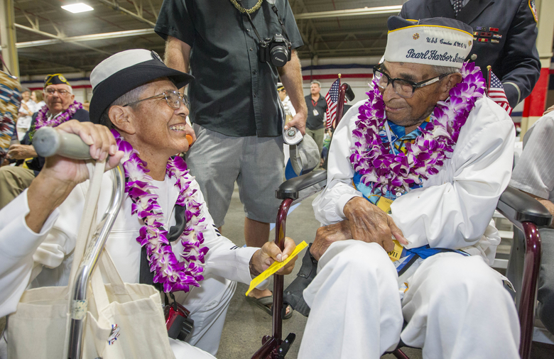 FILE – In this Dec. 7, 2016, file photo, Kathleen Chavez, left, talks with her father Ray Chavez, right, age 104, of the USS Condor, the oldest living survivor from the Pearl Harbor attacks along with the remaining living survivors of the USS Arizona gathered at the World War II Valor in the Pacific National Monument at Joint Base Pearl Harbor-Hickam in Honolulu. Ray Chavez, the oldest U.S. military survivor of the Dec. 7, 1941, attack on Pearl Harbor that plunged the United States into World War II has died at age 106. Chavez's daughter, Kathleen Chavez of Poway, Calif., tells The Associated Press her father died in his sleep Wednesday, Nov. 21, 2018. (AP Photo/Eugene Tanner, File)