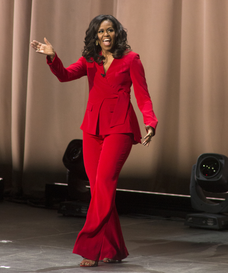 """Former first lady Michelle Obama arrives at the """"Becoming: An Intimate Conversation with Michelle Obama"""" event at the Wells Fargo Center on Thursday, Nov. 29, 2018, in Philadelphia. (Photo by Owen Sweeney/Invision/AP)"""