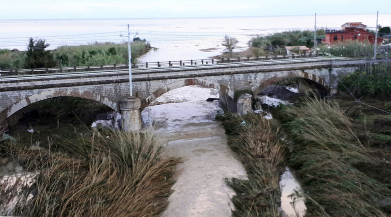 The swollen Milicia river runs in the area where nine people lost their lives when their home was flooded in Casteldaccia, near Palermo, Italy, Sunday, Nov. 4, 2018. Rainstorms lashing Sicily have killed at least 10 people, Italian Premier Giuseppe Conte said before heading Sunday for the stricken Mediterranean island. State radio said nine of those victims were in a home that was flooded by a rapidly swelling river in the countryside near Palermo. (Ruggero Farkas/ANSA via AP)
