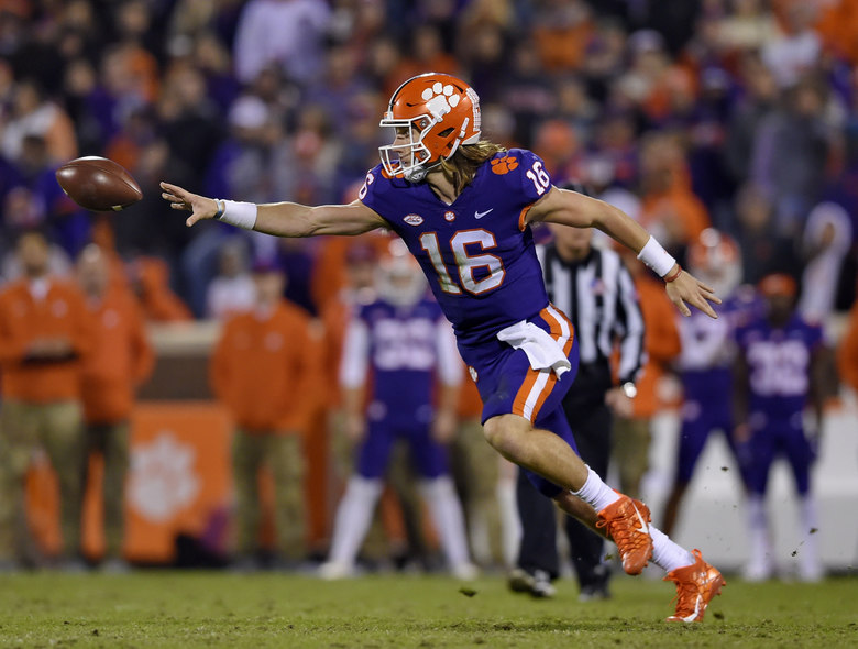 Clemson quarterback Trevor Lawrence tosses the ball to Travis Etienne during the second half of an NCAA college football game against Duke on Saturday, Nov. 17, 2018, in Clemson, S.C. (AP Photo/Richard Shiro)