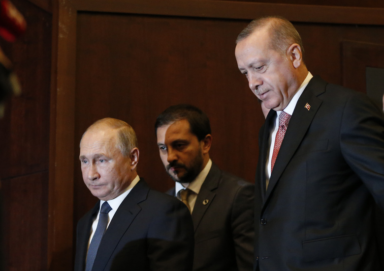 Russian President Vladimir Putin, left, and Turkey's President Recep Tayyip Erdogan, right, arrive to an event marking the completion of one of the phases of the Turkish Stream natural gas pipeline, in Istanbul, Monday, Nov. 19, 2018. (AP Photo/Lefteris Pitarakis)