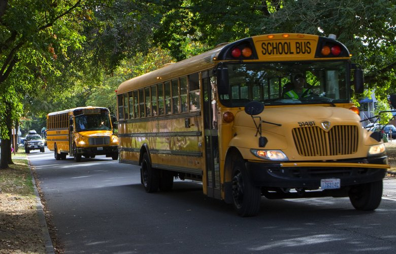 School buses drive kids home from the temporary campus of Queen Anne Elementary School in Seattle's Ravenna neighborhood Wednesday, September 12, 2018.  (Ellen M. Banner / The Seattle Times)