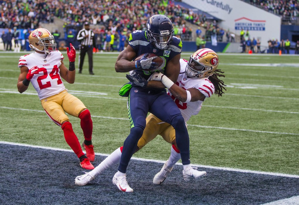 Seattle Seahawks wide receiver Jaron Brown (18) collects a Seattle Seahawks quarterback Russell Wilson pass for a 1st quarter touchdown as the Seattle Seahawks play the San Francisco 49ers at CenturyLink Field on December 2, 2018.  (Mike Siegel / The Seattle Times)