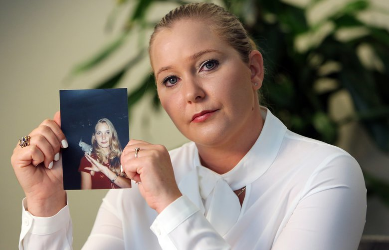 Virginia Roberts holds a photo of herself at age 16, when she says Palm Beach multimillionaire Jeffrey Epstein began abusing her sexually. (Emily Michot/Miami Herald/TNS)  1249605 1249605