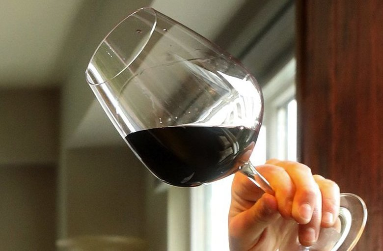 """Sommelier Owen Bargreen found a Kirkland red from Spain that was """"outrageously good value"""" among the two dozen he tasted. (Greg Gilbert / The Seattle Times)"""
