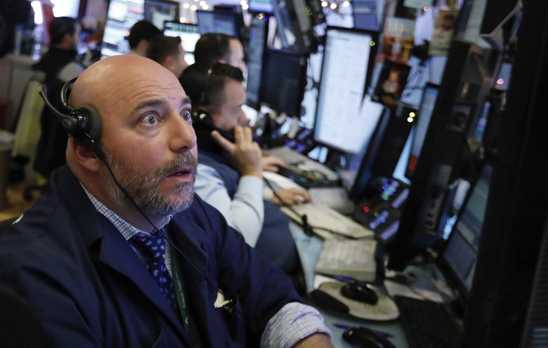 Investors had initially welcomed the trade truce that the Trump administration said was reached over the weekend in Buenos Aires between Presidents Donald Trump and Xi Jingping. But on Tuesday, after a series of confusing and conflicting words from Trump and some senior officials, stocks tumbled. Vincent Napolitano works on the floor of the New York Stock Exchange, Monday. (Richard Drew / The Associated Press)