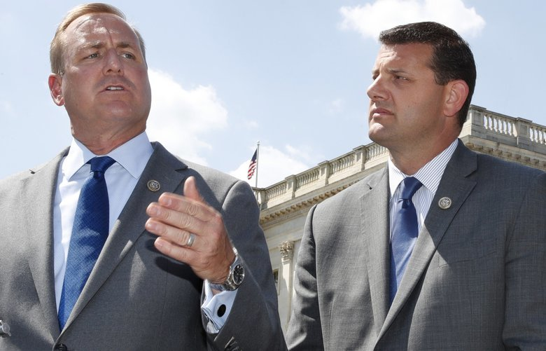 FILE – In this Wednesday, May 9, 2018 file photo, Rep. Jeff Denham, R-Calif., left, speaks next to Rep. David Valadao, R-Calif., during a news conference on Capitol Hill in Washington. The Republican incumbents were swept out of office in 2018 after a tally of late-arriving ballots. (AP Photo/Jacquelyn Martin) NY768 NY768