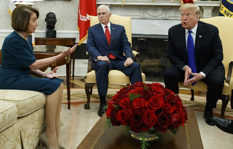 Vice President Mike Pence, center, looks on as House Minority Leader Rep. Nancy Pelosi, D-Calif., and President Donald Trump argue during a meeting in the Oval Office of the White House, Tuesday, Dec. 11, 2018, in Washington. (AP Photo/Evan Vucci) DCEV128 DCEV128