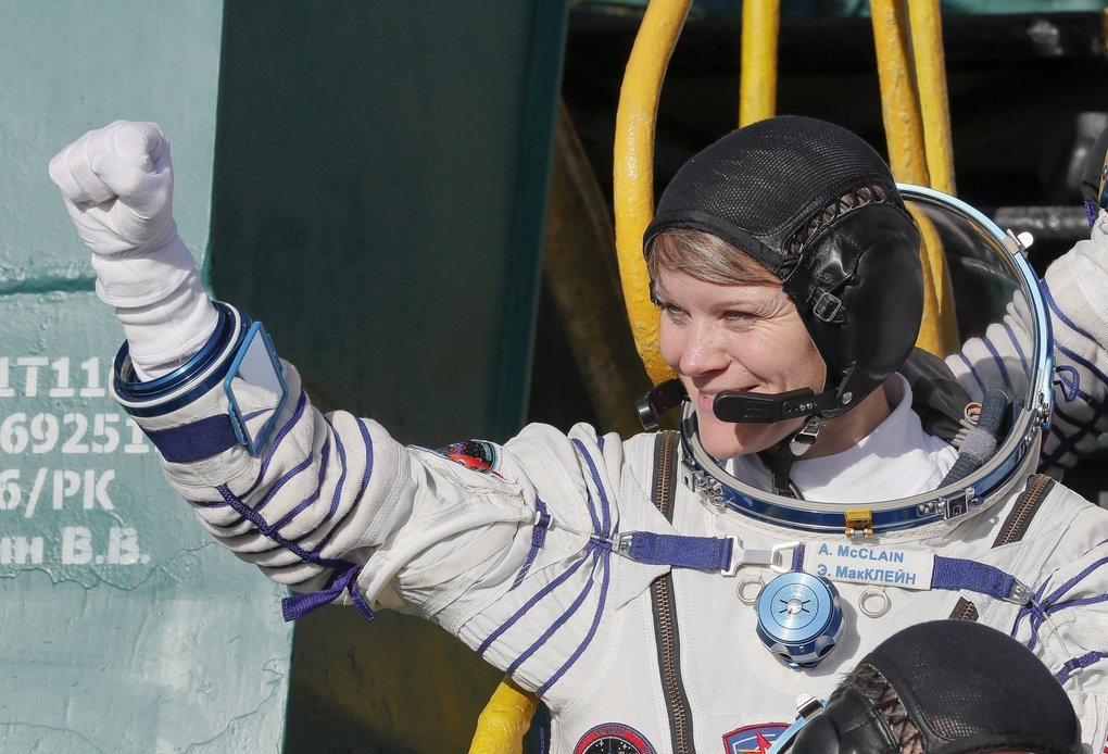 U.S. astronaut Anne McClain, crew member of the mission to the International Space Station,  waves as she boards the rocket prior to the launch of Soyuz-FG rocket at the Russian leased Baikonur cosmodrome, Kazakhstan, on  Dec. 3. (AP Photo/Shamil Zhumatov, Pool)