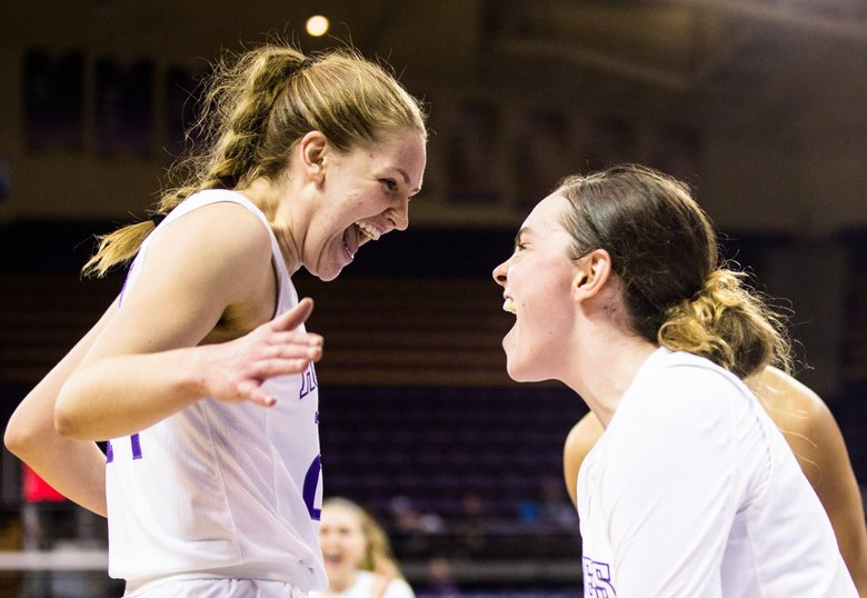 Washington's Jenna Moser (left) celebrates her basket with Hannah Johnson as the Huskies take on the Griz in the first game of the Husky Invitational Tournament at Alaska Airlines Arena on Saturday, December 15. (Rebekah Welch / The Seattle Times)