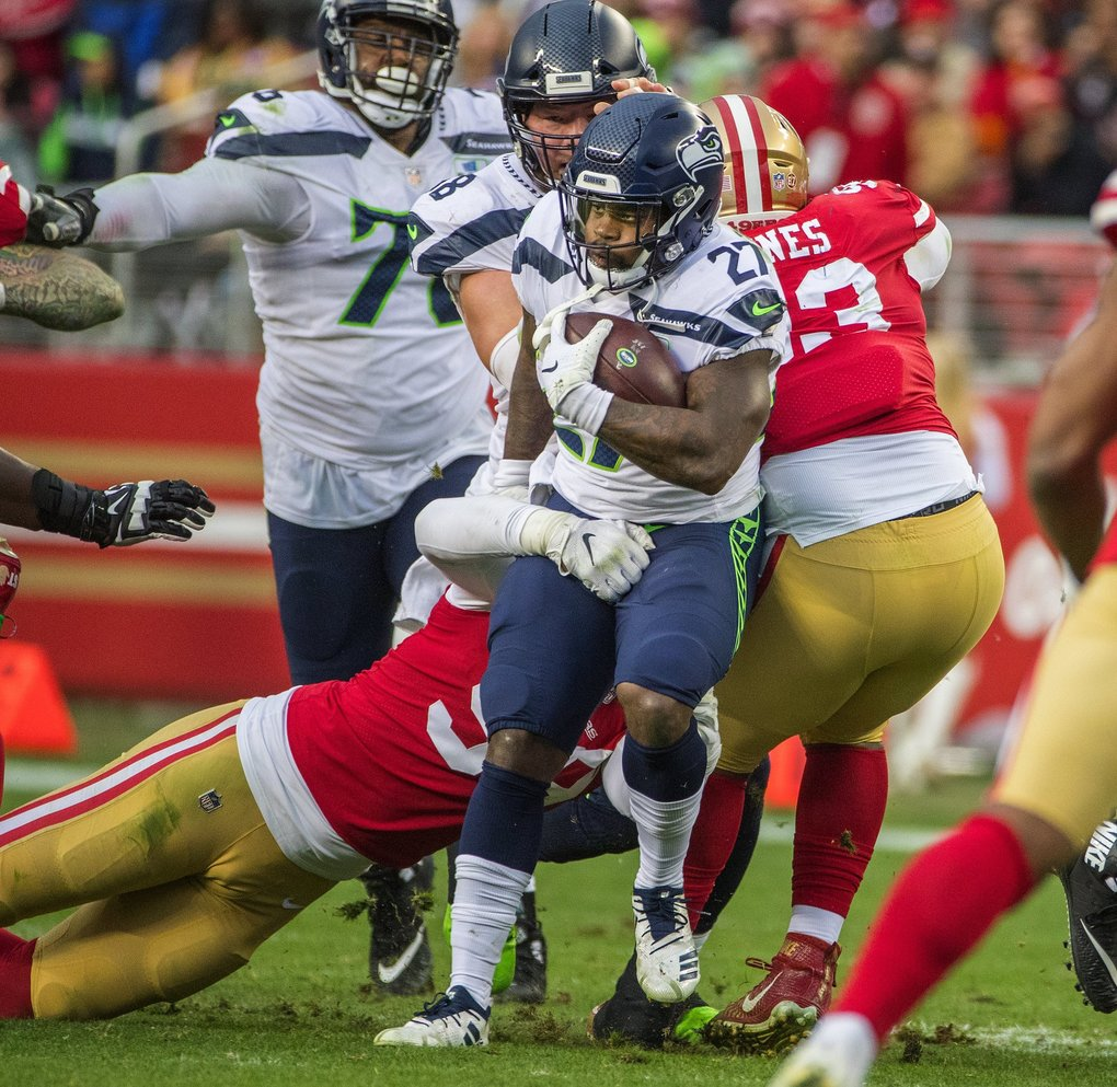Seattle Seahawks running back Mike Davis (27) runs through a crowd of 49ers during second quarter action as the Seattle Seahawks play the San Francisco 49ers at Levi's Stadium in Santa Clara, CA on December 16, 2018. (Mike Siegel / The Seattle Times)